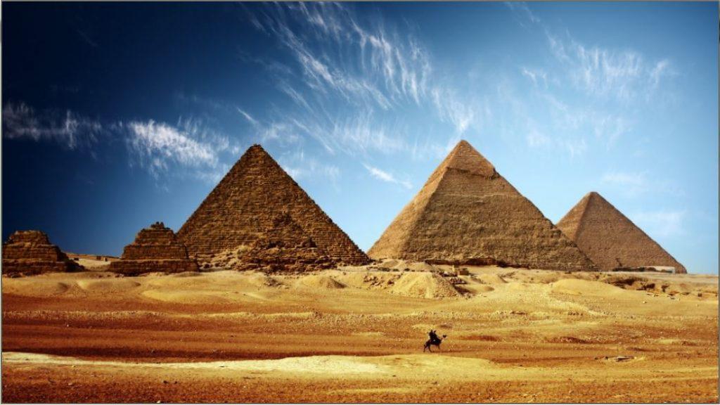pyramids_egypt_sand_desert_camel_sky_heat_47995_3840x2160