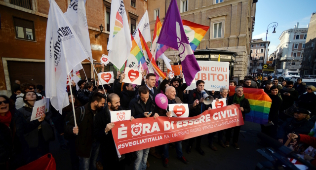 Supporters of same-sex civil unions demonstrate in Rome's Piazza delle cinque Lune on January 27, 2016 .   Italy's Senate began examining a civil union bill for same-sex couples, a topic which has profoundly divided the country and could prove toxic for Prime Minister Matteo Renzi's government. A vote is expected mid-February, after which the text will have to go before the lower house of Parliament, where negotiations are already underway to try to ensure the bill passes smoothly -- avoiding a potential return to the Senate.  / AFP / FILIPPO MONTEFORTE        (Photo credit should read FILIPPO MONTEFORTE/AFP/Getty Images)